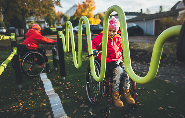 Disabled children playing in park