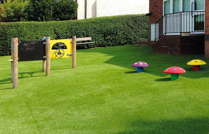 fake grass with play equipment
