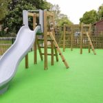 slide and climbing frame with green rubber flooring