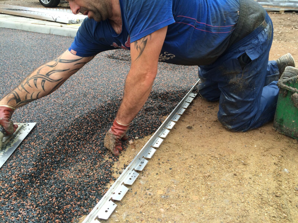 safety surface being laid