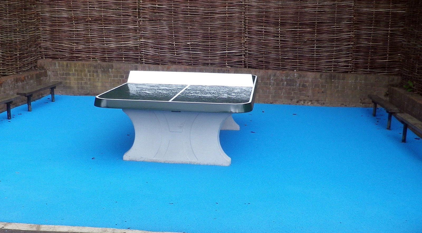 outdoor table tennis table on wet pour rubber surface