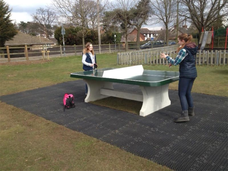 table tennis table on rubber matting