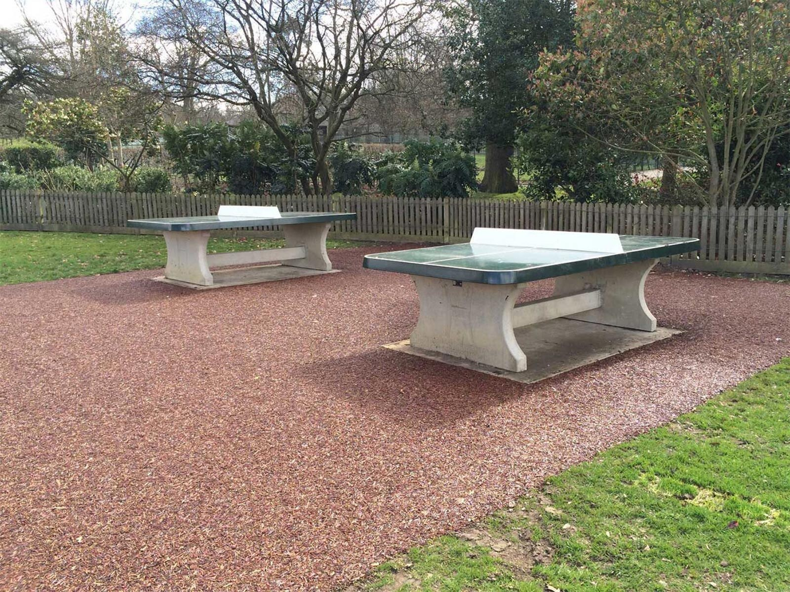 table tennis table on tiger mulch rubber surface