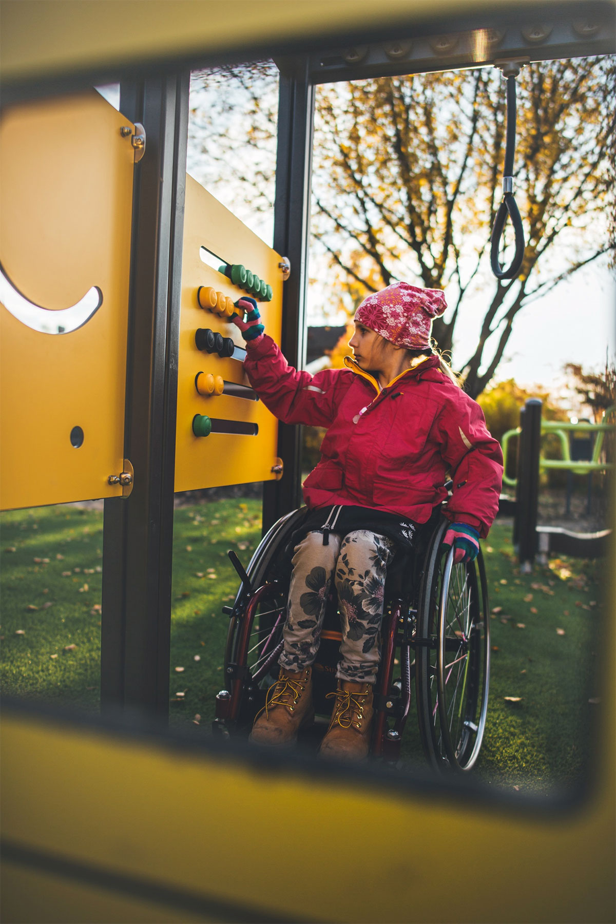 girl in wheelchair playing in inclusive play area