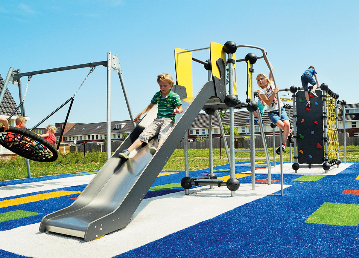 Slide in playground on safety surface