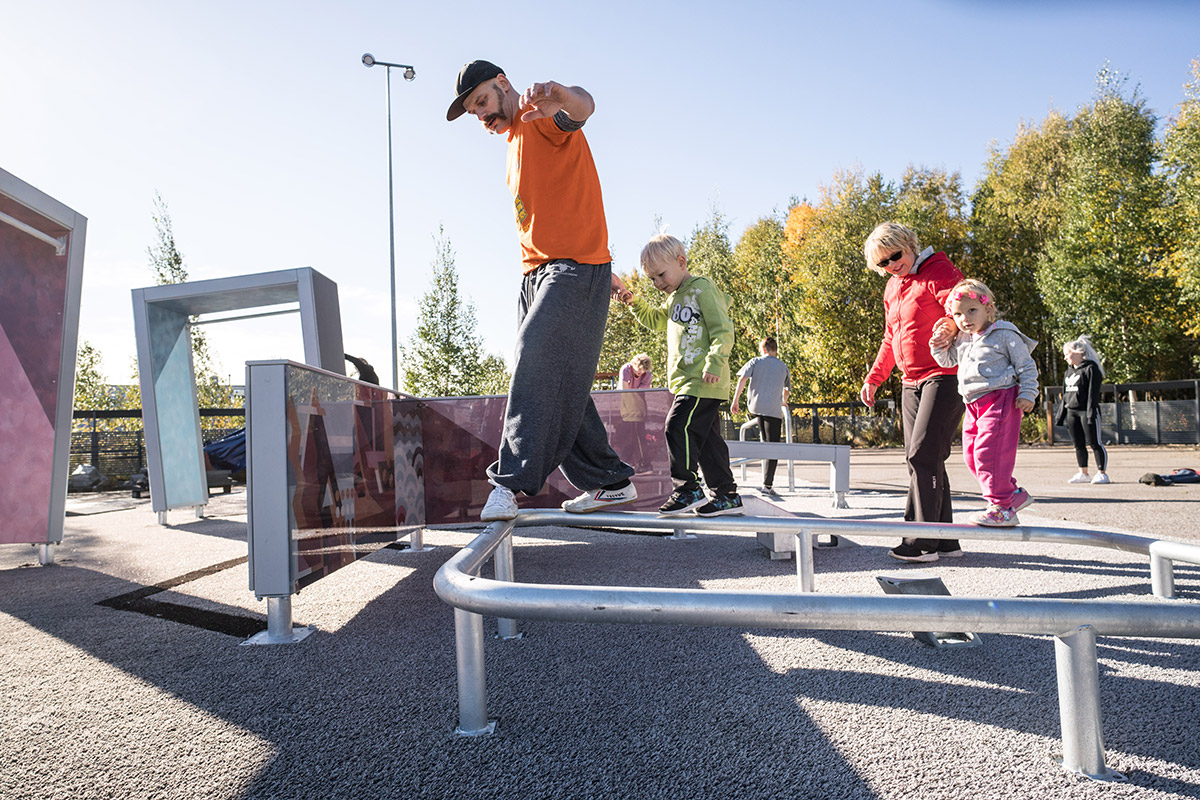 Parkour equipment in park man and children playing
