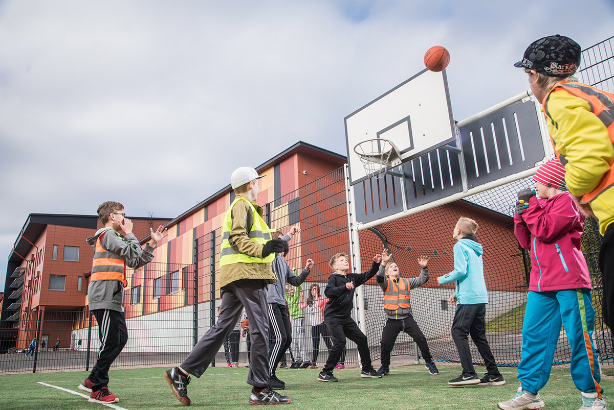 children playing in muga basketball hoop