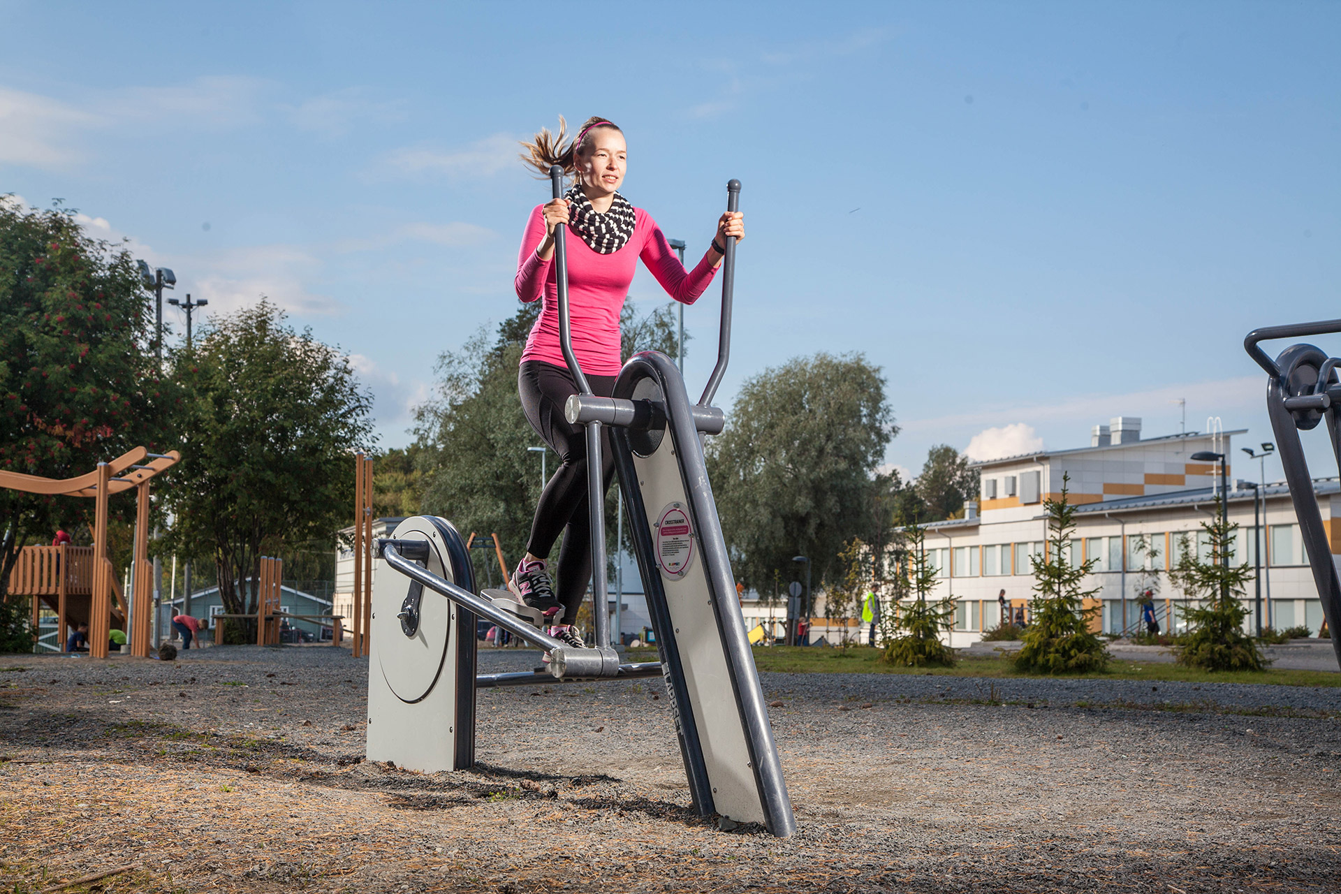 outdoor gym cross trainer being used by lady