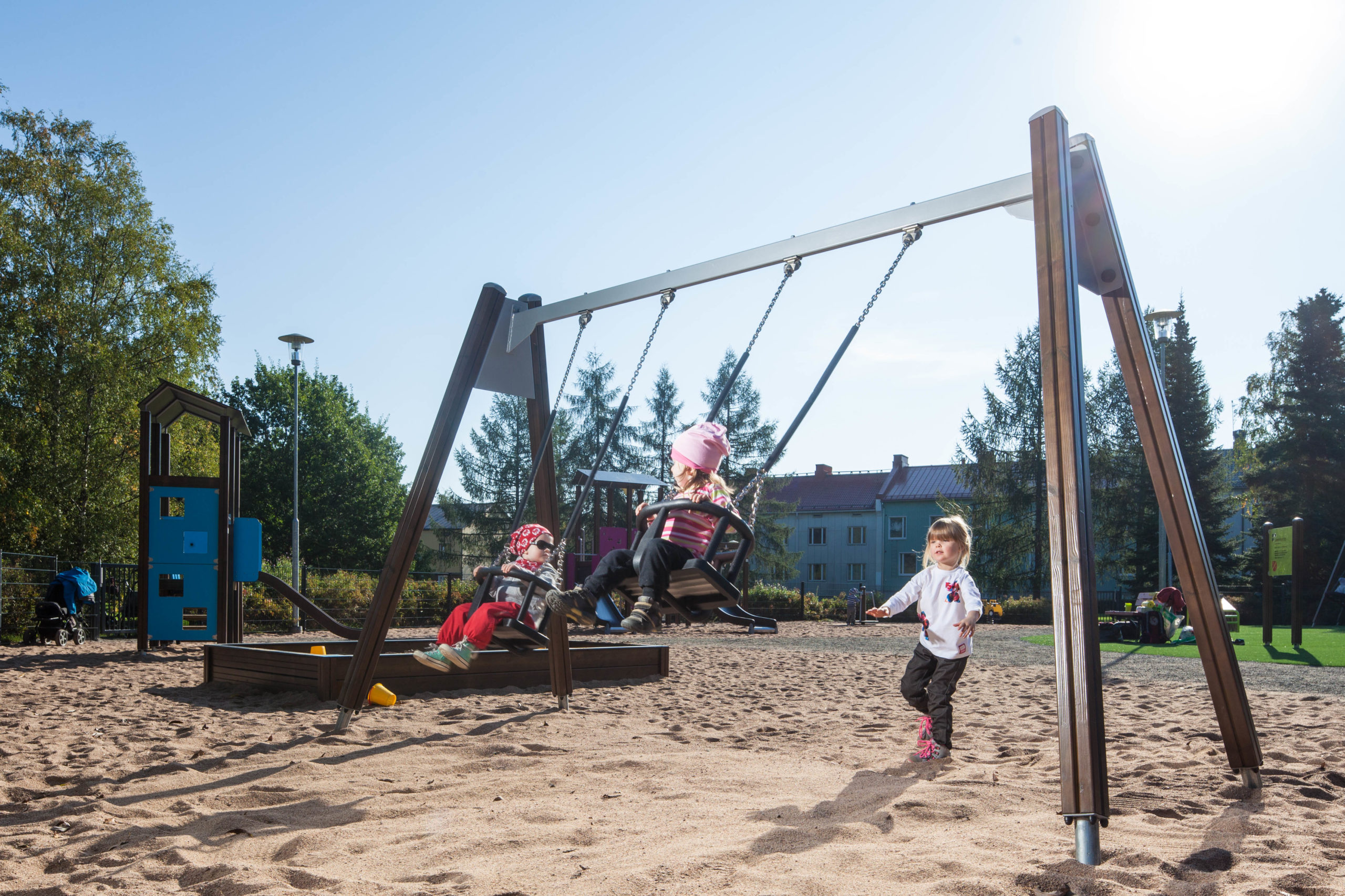 swing set in park with child cradle seat