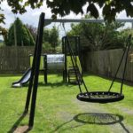 small park swing and activity tower