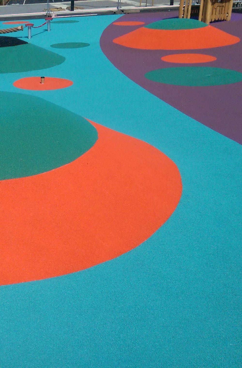 coloured wet pour rubber safety surface