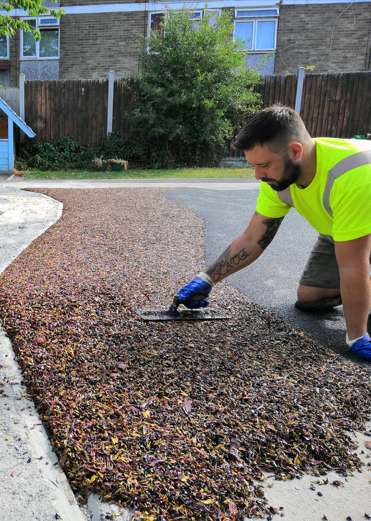 laying rubber mulch safety surface