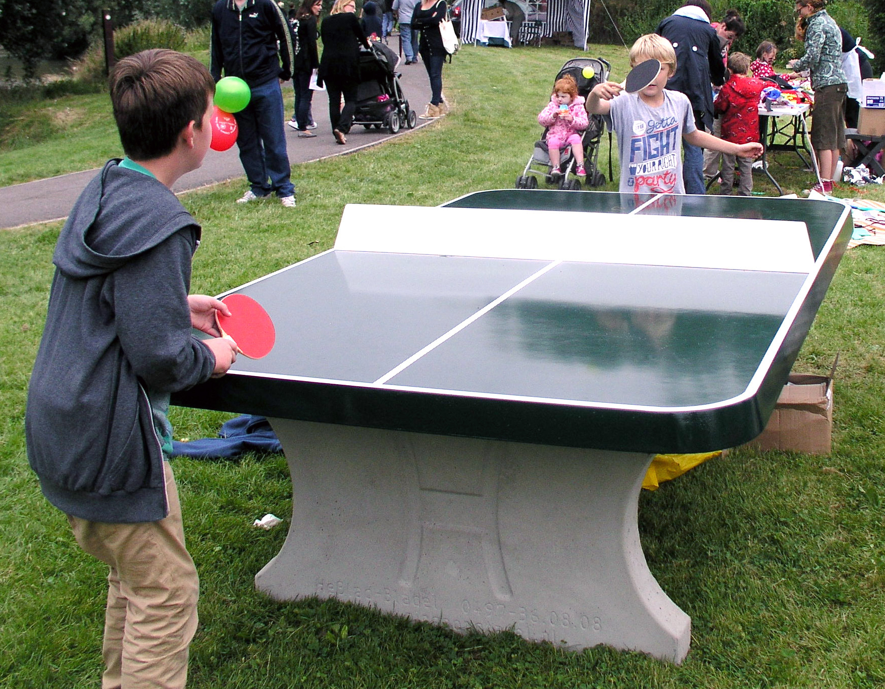 green concrete table tennis table with rounded corners