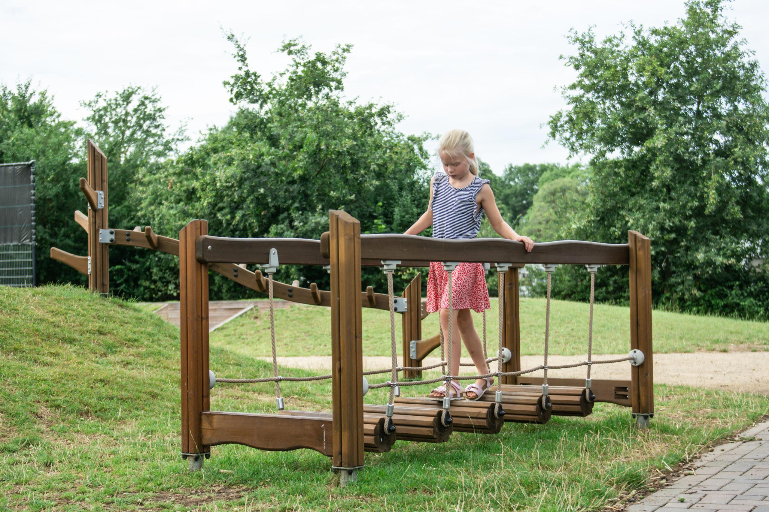 wooden wobble bridge in playground