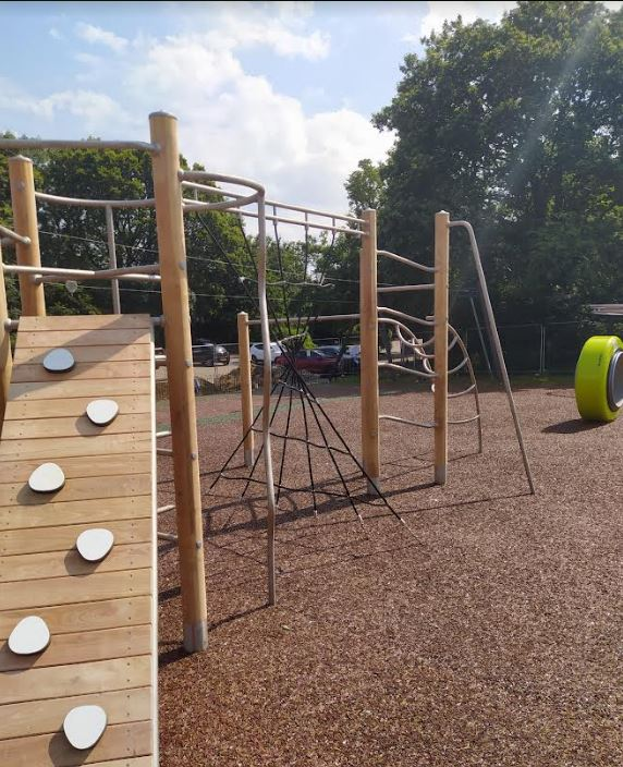 wooden climbing frame on rubber mulch safety surface
