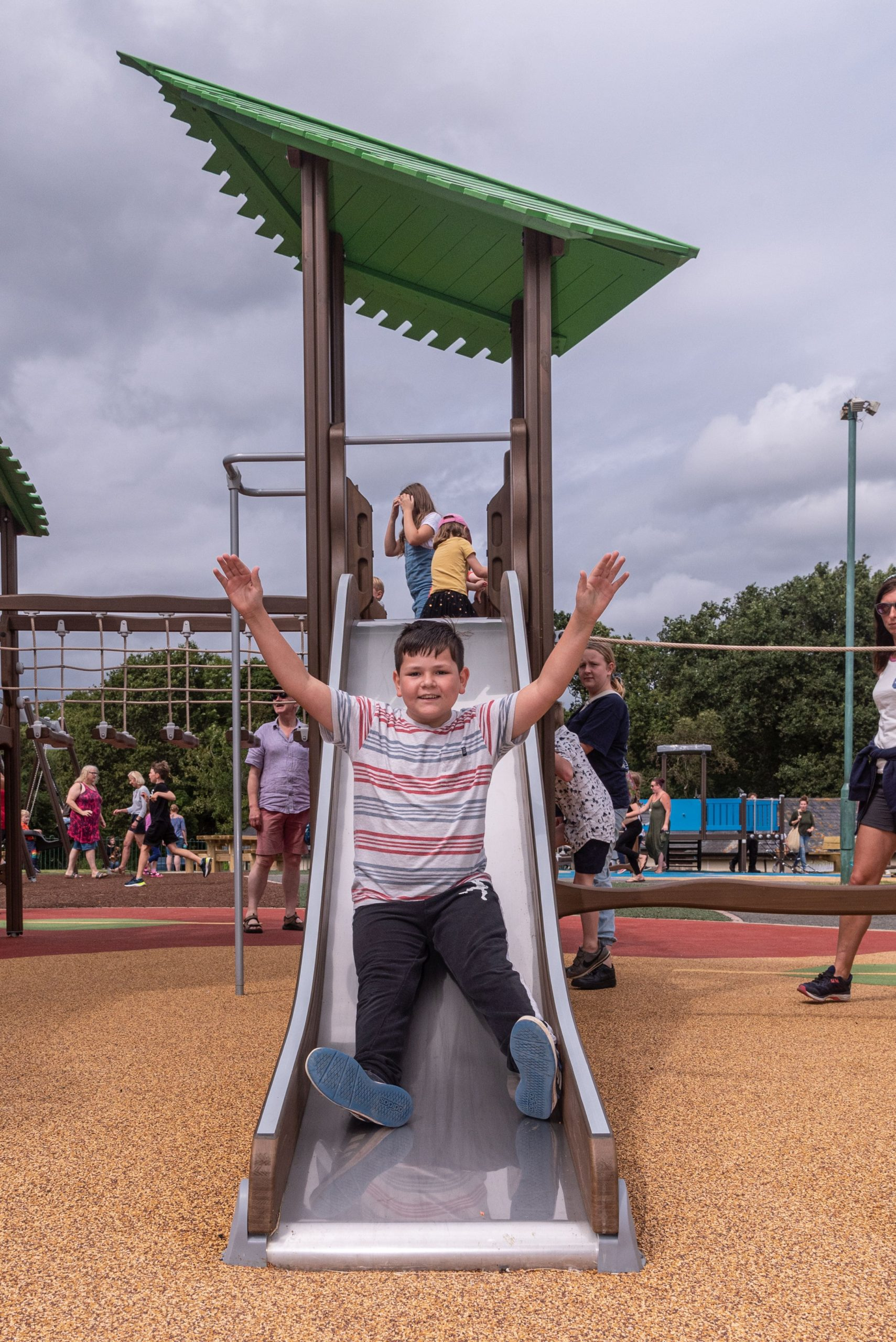 Child going down slide